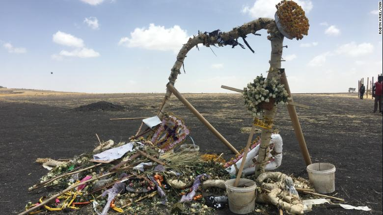 Makeshift memorials left at scene honoring family members who died on the Ethiopia Airlines flight ET302.