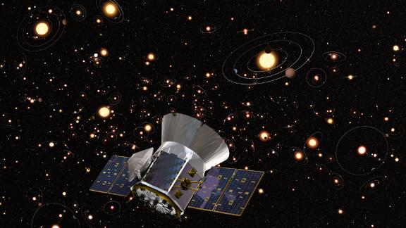 An artist's concept of TESS against a background of stars and orbiting planets in the Milky Way.