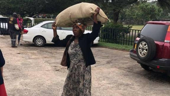 Plaxedes Dilon walked several miles to the Highlands Presbyterian Church in Zimbabwe's capital to deliver donations to cyclone survivors.