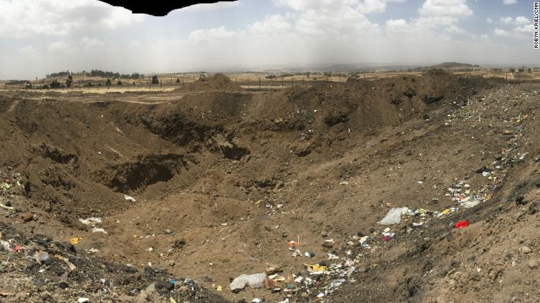 An inspection of the crater left behind by the Ethiopian Airlines ET302 crash