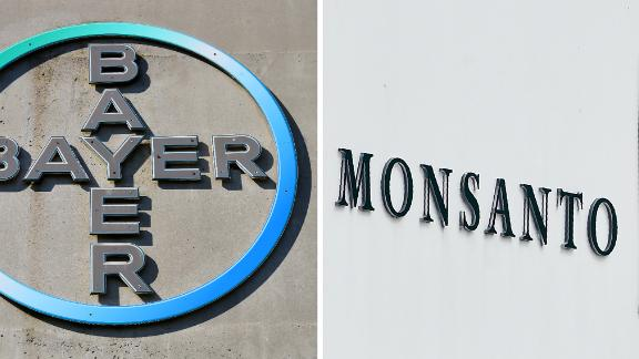 (COMBO) This combination of file pictures created on September 14, 2016 shows the logo of German pharmaceutical giant Bayer (L, on September 8, 2016 in Leverkusen) and the logo of Monsanto at it's Belgian manufacturing site and operations centre (on May 24, 2016 in Lillo near Antwerp). - German pharmaceutical and chemical group Bayer is preparing to increase its takeover offer for US seeds and pesticides giant Monsanto for a fourth time, a report said on September 13, 2016. (Photo by Patrik STOLLARZ and John THYS / AFP)        (Photo credit should read PATRIK STOLLARZ,JOHN THYS/AFP/Getty Images)