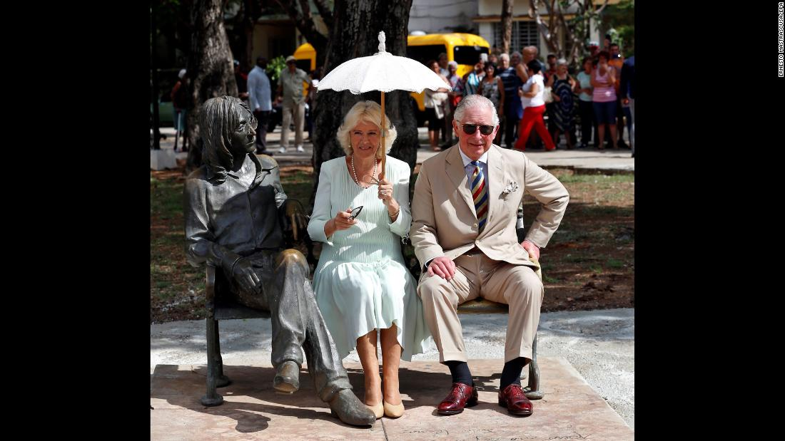 "Britain's Prince Charles and his wife Camilla, the Duchess of Cornwall, sit next to a John Lennon statue during <a href=""https://www.cnn.com/2019/03/24/americas/cuba-prince-charles-camilla-us-criticism-gbr-intl/index.html"" target=""_blank"">a visit to Cuba</a> on Tuesday, March 26. It's the first official visit to Cuba for members of the British royal family."