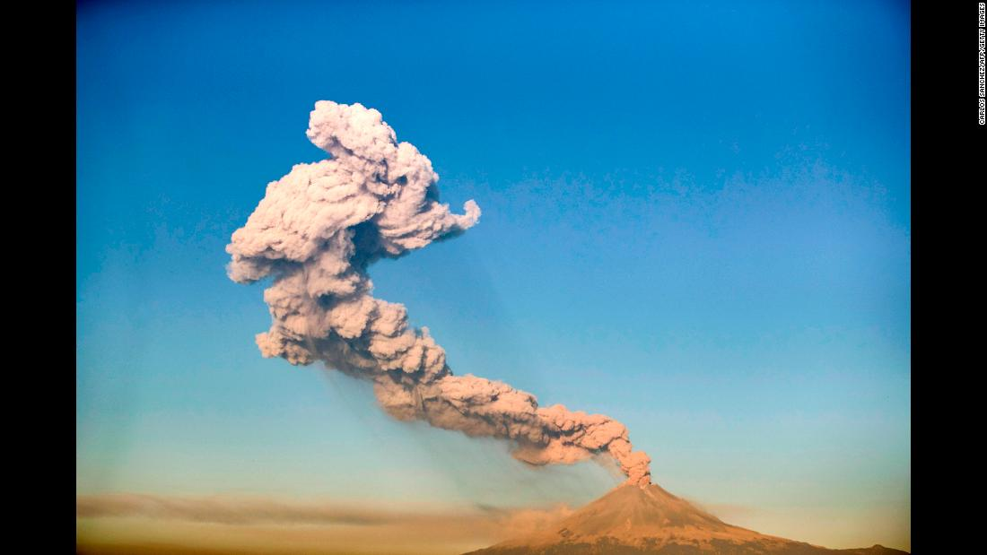 The Popocatepetl volcano spews ash and smoke near Puebla, Mexico, on Thursday, March 28.