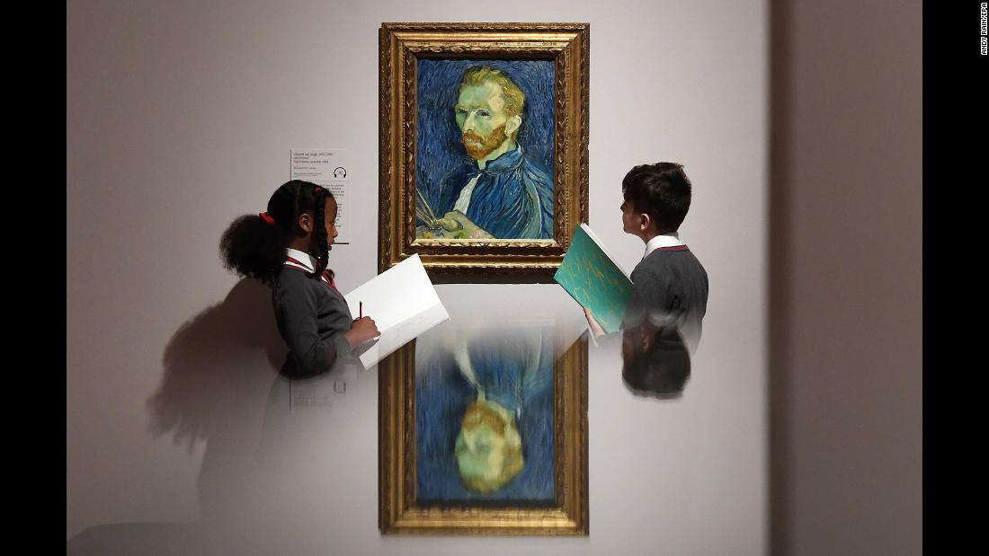 Schoolchildren look at a Vincent Van Gogh painting at the Tate Britain museum in London on Monday, March 25.
