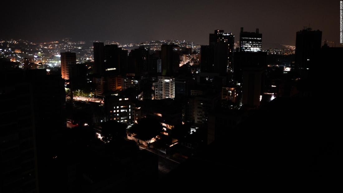 The Altamira neighborhood is partially illuminated during a power outage in Caracas, Venezuela, on Tuesday, March 26. Power outages have been frequent in Venezuela over the past month.