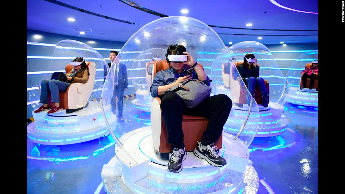 People in Beijing visit a theater for virtual-reality movies on Wednesday, March 27.