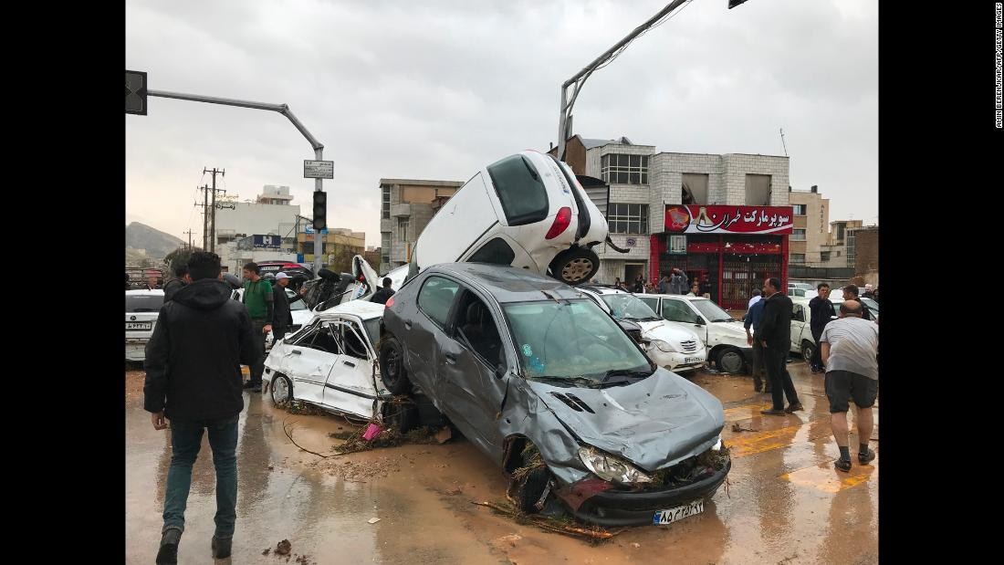 "Cars are piled up on a street after <a href=""https://www.cnn.com/2019/03/25/middleeast/iran-flash-flooding-kills-19/index.html"" target=""_blank"">flash flooding</a> in Shiraz, Iran, on Monday, March 25."