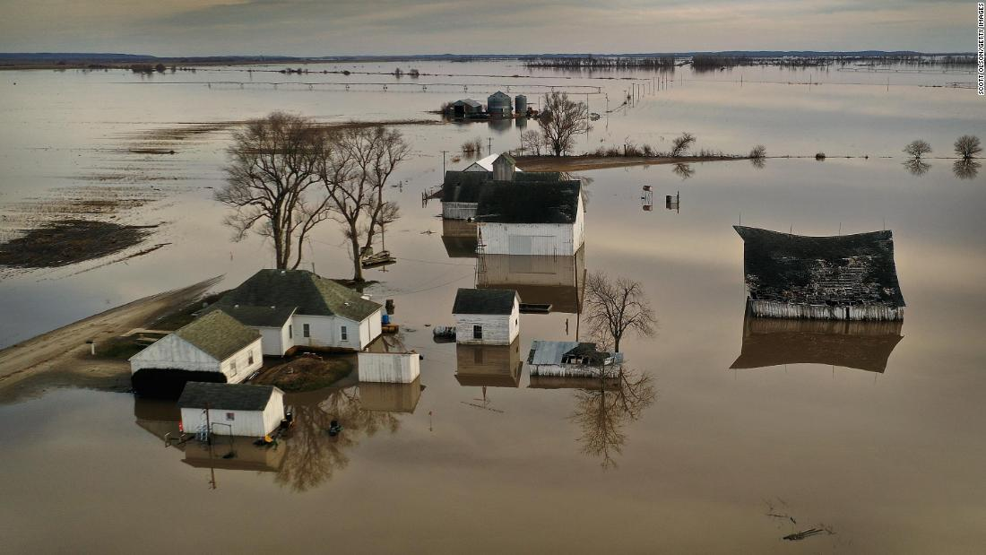 "Floodwaters surround a farm in Craig, Missouri, on Friday, March 25. <a href=""https://www.cnn.com/2019/03/21/us/floods-nebraska-iowa-agriculture-farm-loss/index.html"" target=""_blank"">Floodwaters washed over the Plains and Upper Midwest</a> as a bomb cyclone dropped heavy rain and snow last week -- and as previous snow and ice melted."