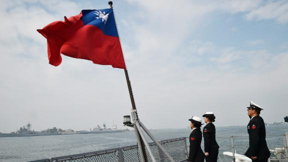 Taiwanese sailors salute the island's flag on the deck of the Panshih supply ship after taking part in annual drills, at the Tsoying naval base in Kaohsiung on January 31, 2018. Taiwanese troops staged live-fire exercises the day before on January 30 to simulate fending off an attempted invasion, as the island's main threat China steps up pressure on President Tsai Ing -Wen. / AFP PHOTO / Mandy CHENG        (Photo credit should read MANDY CHENG/AFP/Getty Images)