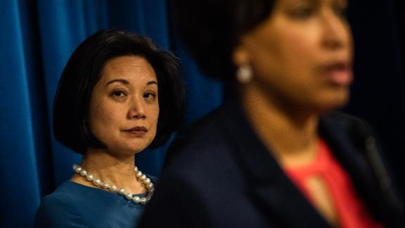 US Attorney for the District of Columbia Jessie Liu looks on as Washington, DC, Mayor Muriel Bowser speak during a news conference on Wednesday, February 6, 2019, in Washington.