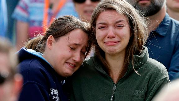 Women react as the New Zealand national anthem is sung during a national remembrance service in Hagley Park for the victims of the March 15 mosque terrorist attack in Christchurch, New Zealand.