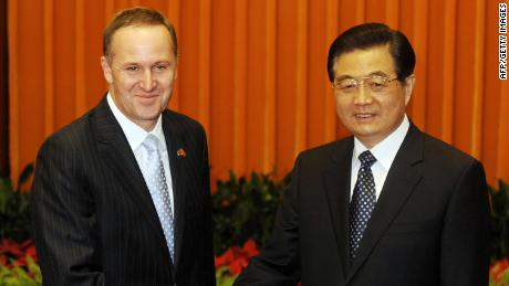 New Zealand Prime Minister John Key (L) shakes the Chinese President Hu Jintao during her meeting in the Great Hall of the People's Hand on April 14, 2009 in Beijing.