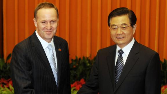 New Zealand Prime Minister John Key (L) shakes hands with Chinese President Hu Jintao during their meeting at the Great Hall of the People in Beijing on April 14, 2009.