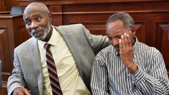 Nathan Myers, left, with his uncle, Clifford Williams, during a news conference Thursday in Jacksonville, Florida.