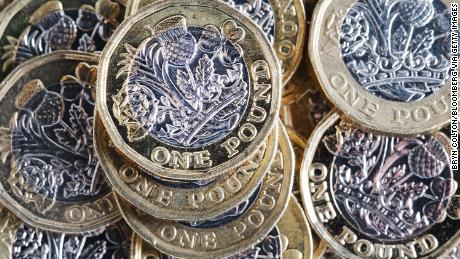 A collection of British one pound coins sit in this arranged photograph in London, U.K., on Tuesday, Feb 12, 2019. The pound was set for its biggest weekly decline in almost four months after lawmakers dealt U.K. Prime Minister Theresa May another defeat in Parliament as they refused to endorse her Brexit strategy. Photographer: Bryn Colton/Bloomberg via Getty Images