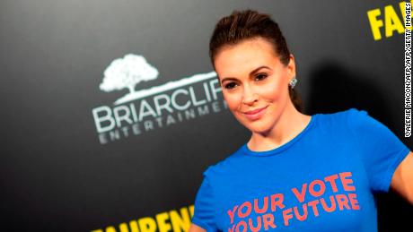 """US actress/activist Alyssa Milano arrives for the premiere of """"Fahrenheit 11/9"""" at the Samuel Goldwyn theatre in Beverly Hills, California on September 19, 2018. (Photo by VALERIE MACON / AFP) (Photo credit should read VALERIE MACON/AFP/Getty Images)"""