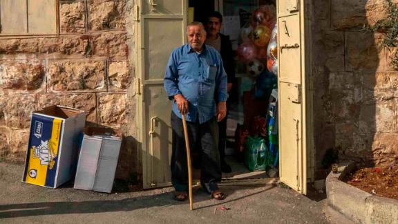Abu Jalal owns a shop right in front of Zein Idris's school and was present when the soldiers marched him out.