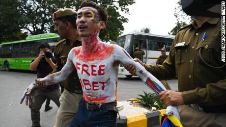 A Tibetan exile activist arrested by the Indian police during a protest near the Chinese Embassy in New Delhi in March 12.