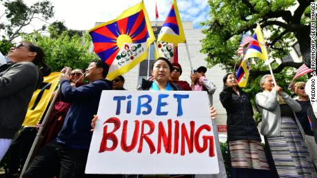 Tibetan flags are displayed as people gather to protest in front of the Consulate General of China Angeles, California, March 10.