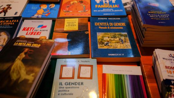 """Books on gender identity and the """"natural family"""" are seen at a trade stall inside the WCF Verona."""