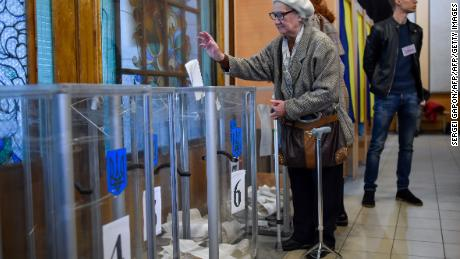 A woman casts her ballot at a polling station in Kiev during Sunday's election.