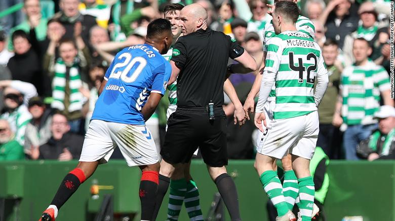 Alfredo Morelos argues with referee Bobby Madden after he is shown a red card.