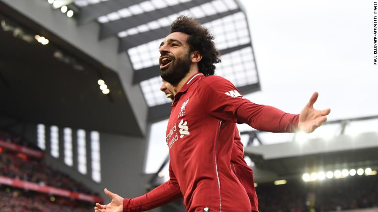 e89d22d80 Liverpool s Egyptian midfielder Mohamed Salah celebrates after a late own  goal from Tottenham Hotspur s Belgian defender