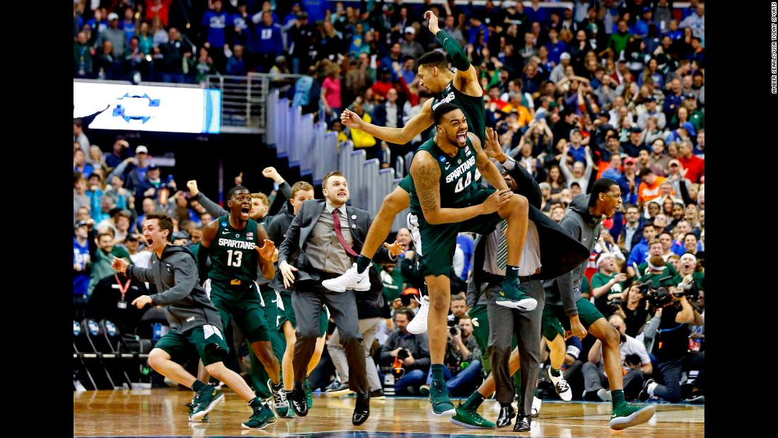 "Michigan State Spartans teammates Nick Ward (44) and Kenny Goins (25) celebrate after <a href=""https://bleacherreport.com/articles/2828858-cassius-winston-michigan-st-stun-zion-williamson-duke-to-advance-to-final-four"" target=""_blank"">beating the No.1 overall seed</a> Duke Blue Devils in their Elite Eight matchup of the 2019 NCAA Tournament at Capital One Arena on Sunday, March 31. The Spartans' win advances them to the Final Four for the 10th time in program history."