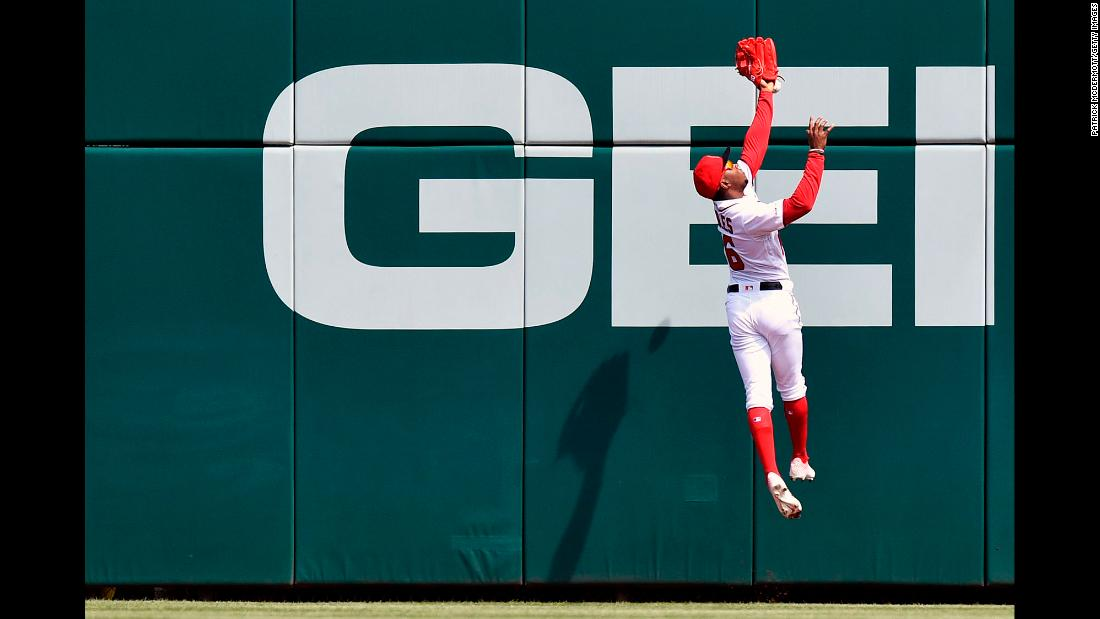 Victor Robles of the Washington Nationals misses a fly ball hit by Jeff McNeil of the New York Mets during the first inning of their game at Nationals Park in Washington, DC, on Saturday, March 30.