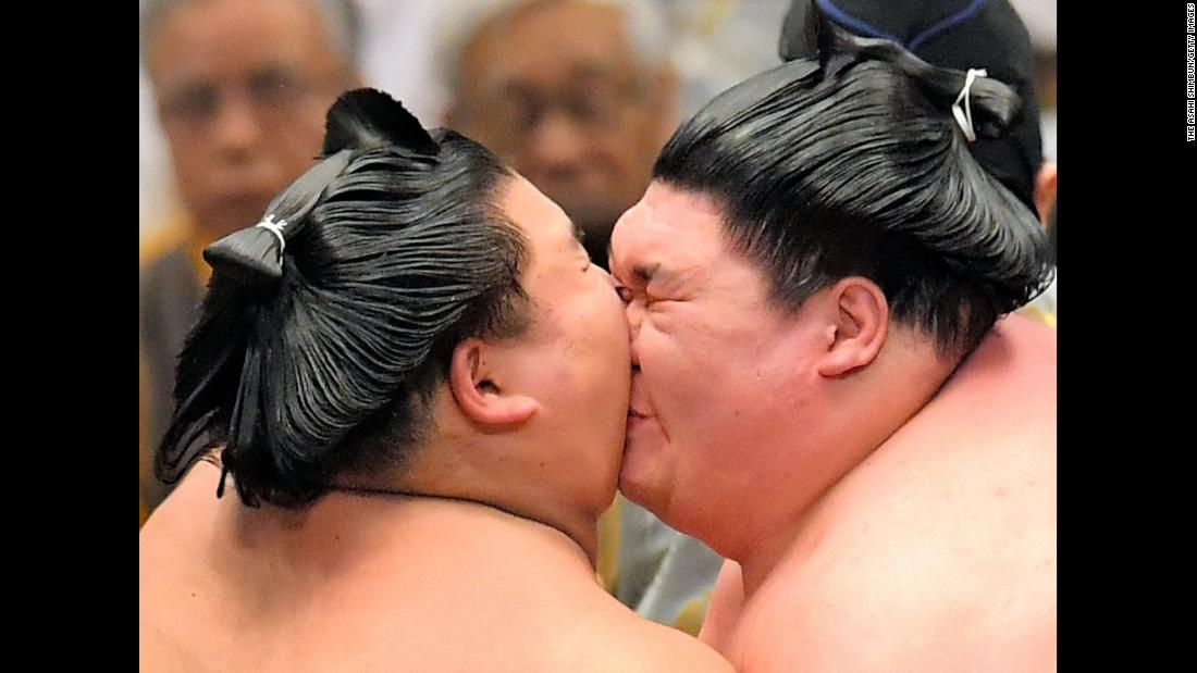 Daishoho, left, and Yago bump heads during their match on day 15 of the Grand Sumo Spring Tournament in Osaka, Japan, on Sunday, March 24.