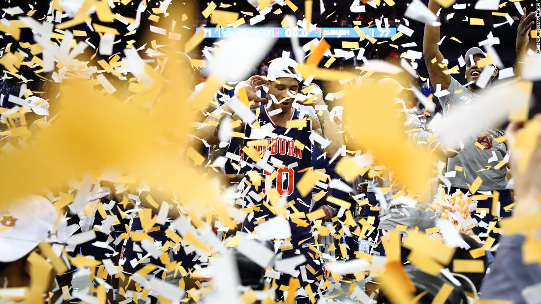Samir Doughty of the Auburn Tigers celebrates after defeating the Kentucky Wildcats 77-71 in overtime during the 2019 NCAA Basketball Tournament Midwest Regional at Sprint Center in Kansas City, Missouri, on March 31.