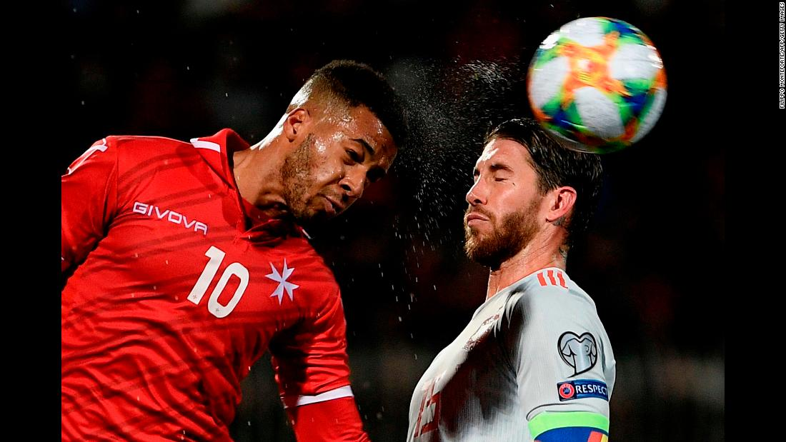 Malta's forward Kyrian Nwoko (L) and Spain's defender Sergio Ramos go for a header during the Euro 2020 Group F qualifying football match at the Ta' Qali Stadium in Malta on March 26.