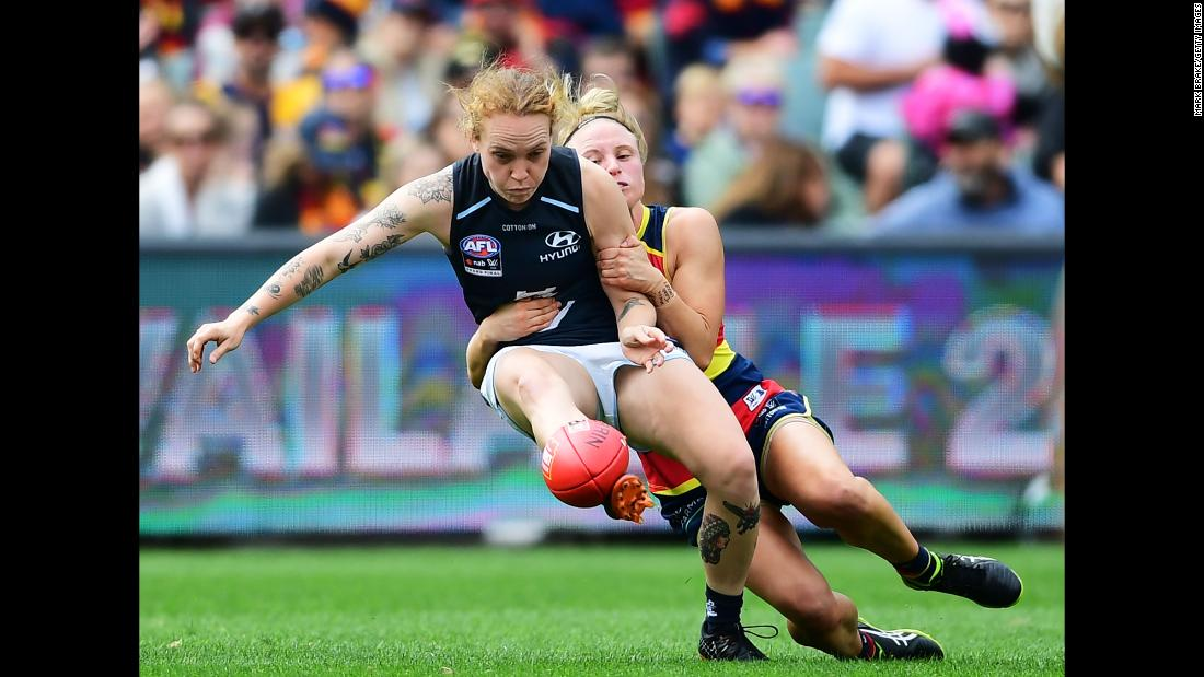 Dayna Cox of the Adelaide Crows tackles Tilly Lucas-Rodd of Carlton during the AFLW Grand Final match at Adelaide Oval on March 31 in Adelaide, Australia.