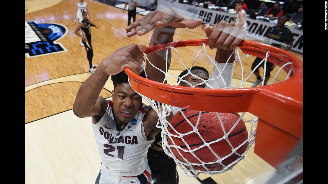 Rui Hachimura of the Gonzaga Bulldogs dunks the ball against Mfiondu Kabengele of the Florida State Seminoles during their Sweet Sixteen game at Honda Center in Anaheim, California on Thursday, March 28. The Bulldogs defeated the Seminoles 72-58 to advance to the Elite Eight.