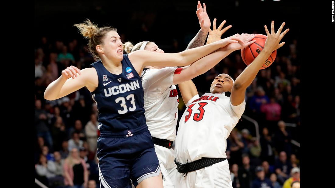 "UConn Huskies guard Katie Lou Samuelson knocks the ball away from Louisville teammates Sam Fuehring, center, and Bionca Dunham, right, during the first half of the East Regional final of the 2019 NCAA Women's Basketball Tournament in Albany, New York, on March 31. The Huskies, who lost to Louisville earlier in the season, won the game to advance to their <a href=""https://bleacherreport.com/articles/2828859-uconn-makes-record-12th-straight-womens-final-four-in-win-vs-louisville"" target=""_blank"">12th straight Final Four</a>, an NCAA record."