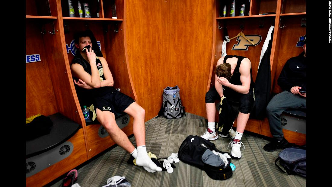 "Purdue Boilermakers teammates Grady Eifert, left, and Ryan Cline sit in their lockers following an <a href=""https://bleacherreport.com/articles/2828727-no-1-virginia-win-in-ot-vs-carsen-edwards-purdue-advance-to-final-four"" target=""_blank"">overtime loss</a> to the Virginia Cavaliers in the Elite Eight of the 2019 NCAA Men's Basketball Tournament. The Boilermakers held the lead late into the second half before Virginia hit a buzzer-beater to send the game into overtime."