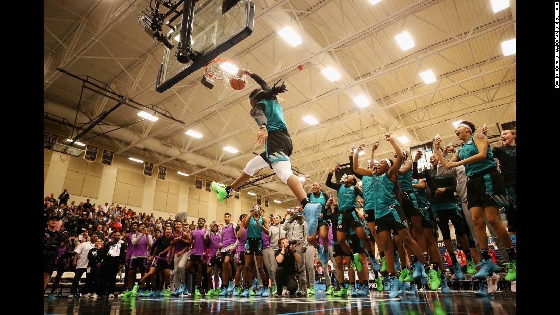 Francesca Belibi dunks during the 2019 Powerade Jam Fest on March 25 in Marietta, Georgia. Belibi, who will continue her basketball career at Stanford, is the first woman since Candace Parker (2004) to win the dunk contest.