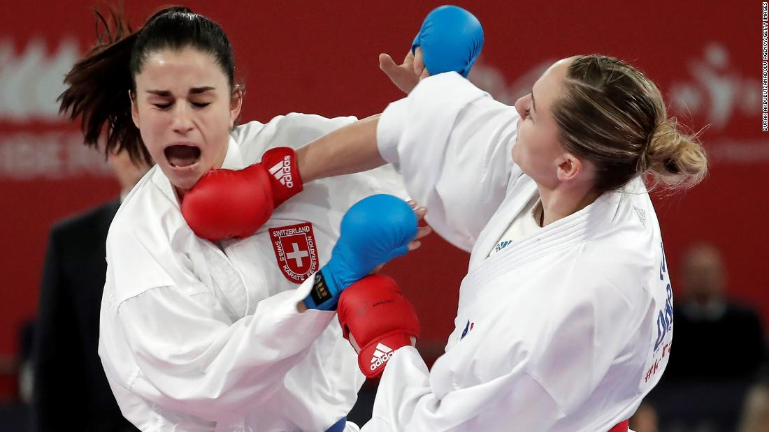 Alizee Agier (R) of France fights Elena Quirici (L) of Switzerland during the 68 kg women's category bronze medal match of 54th European Senior Karate Championship in Guadalajara, Spain, on March 30.