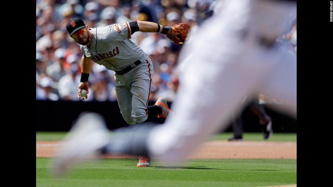 San Francisco Giants third baseman Evan Longoria fields a ball hit by Fernando Tatis Jr. of the San Diego Padres during the fourth inning of a baseball game in San Diego on Thursday, March 28.