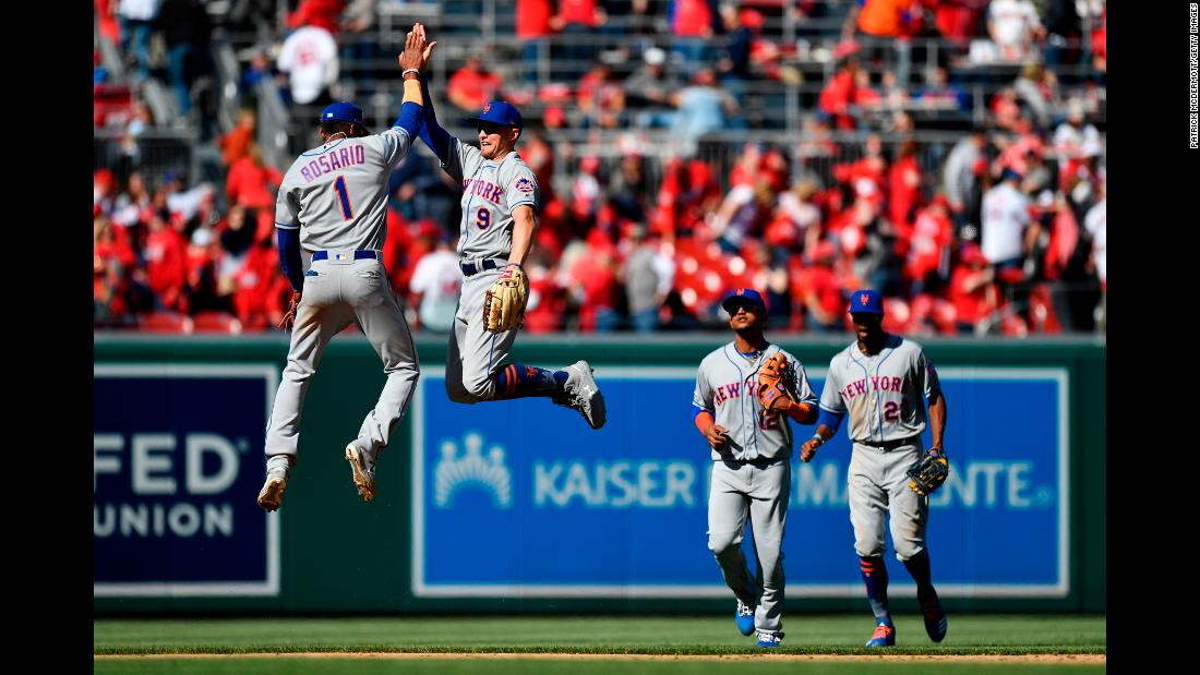 "Amed Rosario (1) and Brandon Nimmo (9) of the New York Mets celebrate after the Mets defeated the Washington Nationals 2-0 on Opening Day at Nationals Park in Washington, DC, on on March 28. <a href=""https://www.cnn.com/2019/03/25/sport/gallery/what-a-shot-sports-0324/index.html"" target=""_blank"">See 29 amazing sports photos from last week.</a>"