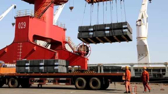 LIANYUNGANG, CHINA - MARCH 31: Cranes load containers onto a vehicle for shipment at a logistics base on March 31, 2019.