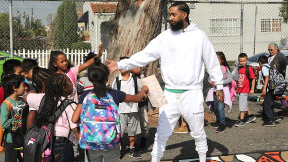 Nipsey Hussle greets kids during a community event in Los Angeles in October.