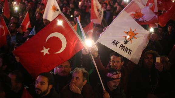 Supporters of ruling AK Party wave flags.