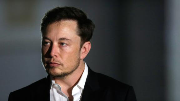 FILE PHOTO-Engineer and tech entrepreneur Elon Musk of The Boring Company listens as Chicago Mayor Rahm Emanuel talks about constructing a high speed transit tunnel at Block 37 during a news conference on June 14, 2018 in Chicago, Illinois.