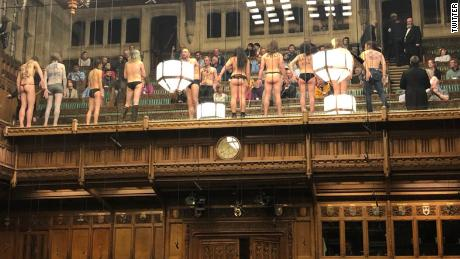 Topless environmental protestors distract lawmakers in UK Parliament during Brexit debate