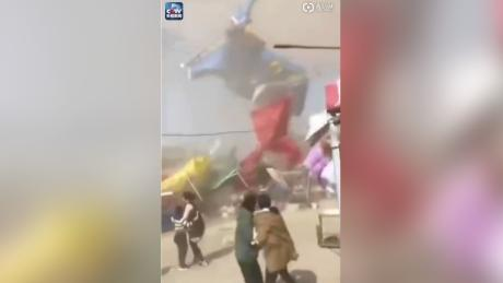 Two children are dead and another 20 people are injured after a bouncy castle was swept into the air by wild winds in central China's Henan province. (Credit: Weibo/CCTV)