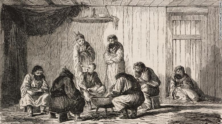 A family of Ainu gives a meal to a Western man in a sketch.