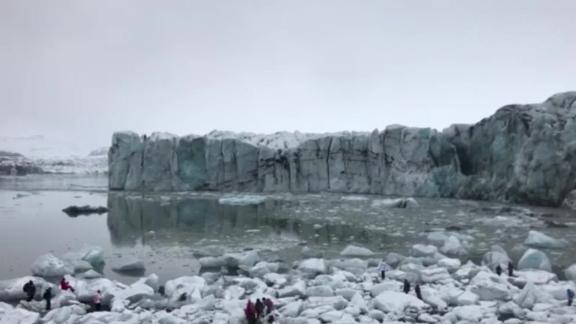 Tourists scramble after a glacier breaks in Iceland.