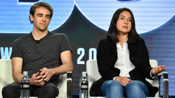 """Tyler Shultz and Erika Cheung speak onstage during a promotional panel for """"The Inventor: Out for Blood in Silicon Valley."""""""