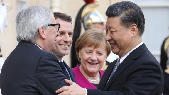 """French President Emmanuel Macron (2ndL) welcomes EU Commission President Jean-Claude Juncker (L),  German Chancellor Angela Merkel (C) and Chinese President Xi Jinping (R) before a meeting at the Elysee Palace in Paris on March 26, 2019. - The leaders of China, France, Germany and the EU were set to meet in Paris on March 26 for """"unprecedented"""" talks on how to improve ties, despite growing jitters over Beijing's massive investments in Europe. (Photo by ludovic MARIN / AFP)        (Photo credit should read LUDOVIC MARIN/AFP/Getty Images)"""